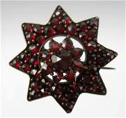 169 Victorian Bohemian garnet pin eight pointed star