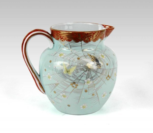 12: Japanese Kutani water pitcher, gilt on red rim and