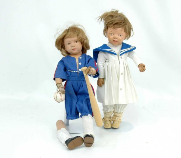 623: Two wooden dolls, both jointed at shoulder, elbow,