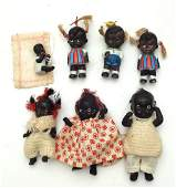 Group of seven bisque small black dolls