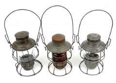 267: Three Adams & Westlake Co. railroad lanterns, one