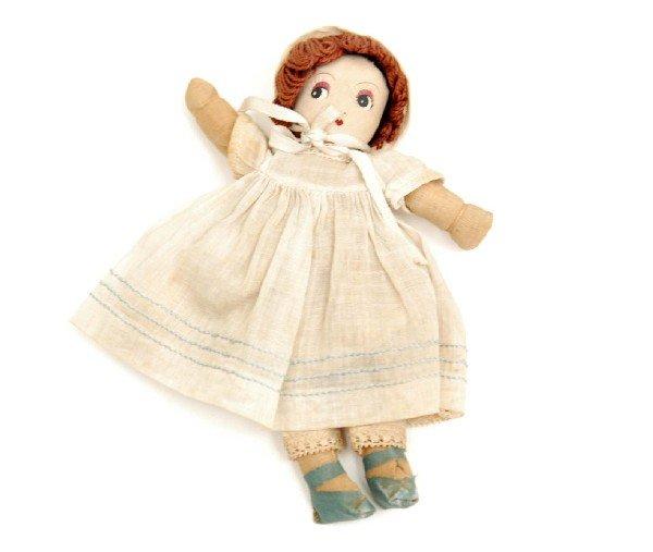 612: Cloth doll, all original, brown yarn hair, hand an