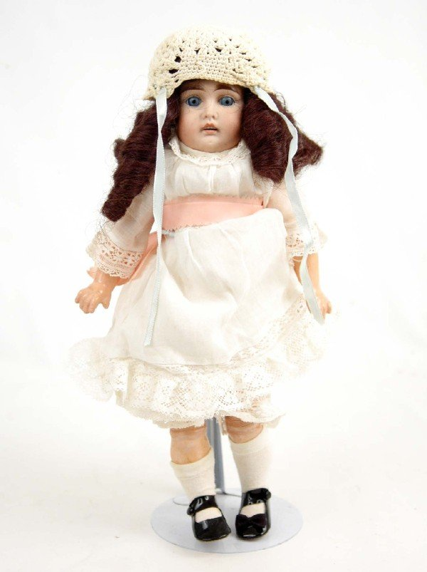 """616: Unmarked bisque head doll, 14"""", black hair, blue o"""