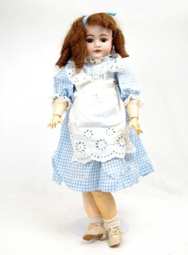 "617: Simon & Halbig bisque head doll, 23"", dark brown h"