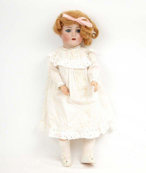 "620: Simon & Halbig bisque head doll, 24"", blonde wig,"