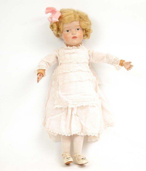 "621: Schoenhut doll, 22"", blonde wig, label on back of"