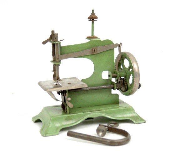 623: Green metal child's sewing machine, unmarked, C. 1
