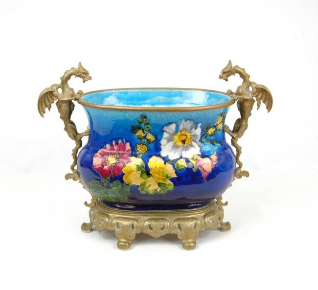 142: Enameled porcelain centerbowl in brass mounting wi