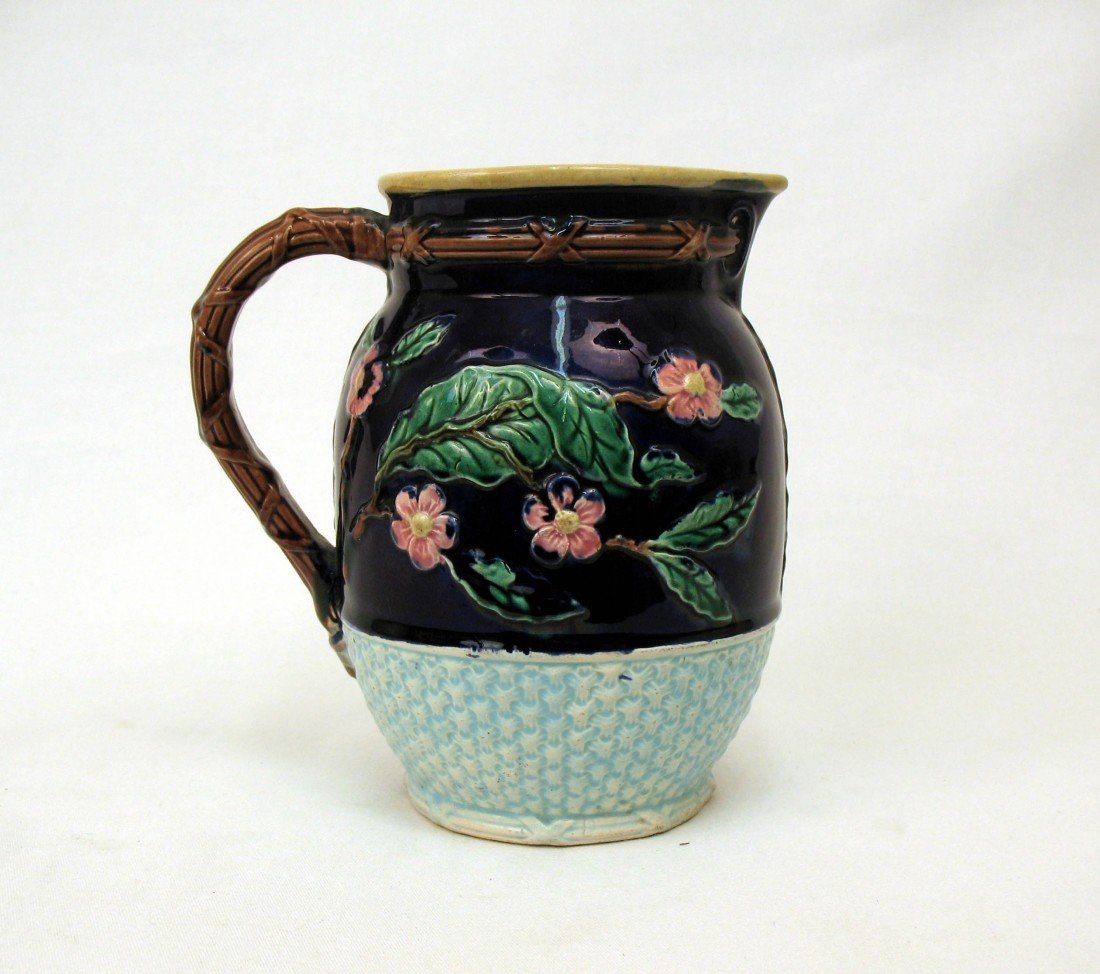 14: Majolica pottery pitcher, with cherry blossoms and