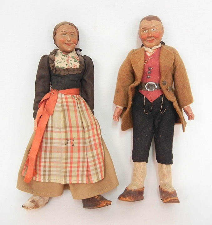 603: Two Austrian dolls with carved wooden heads, paint