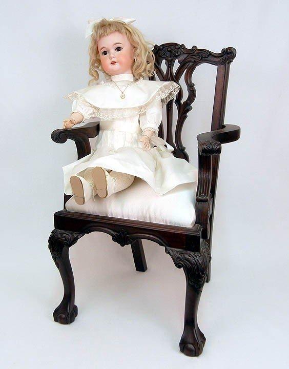 """609: C. M. Bergmann doll seated in chair, 24 1/2"""", bisq"""