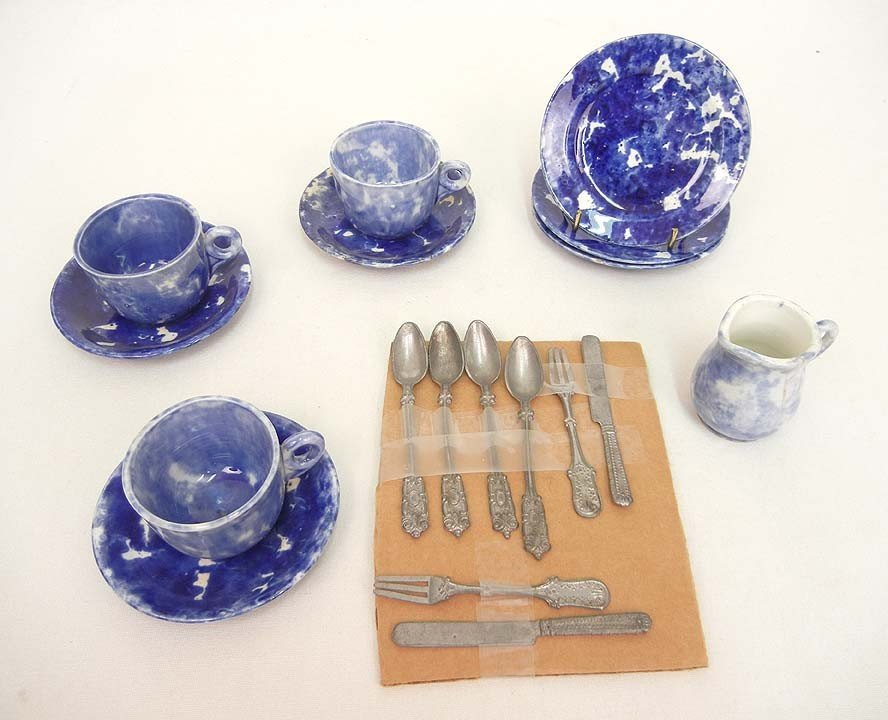 619: Child's spongeware tea set and metal flatware, tea