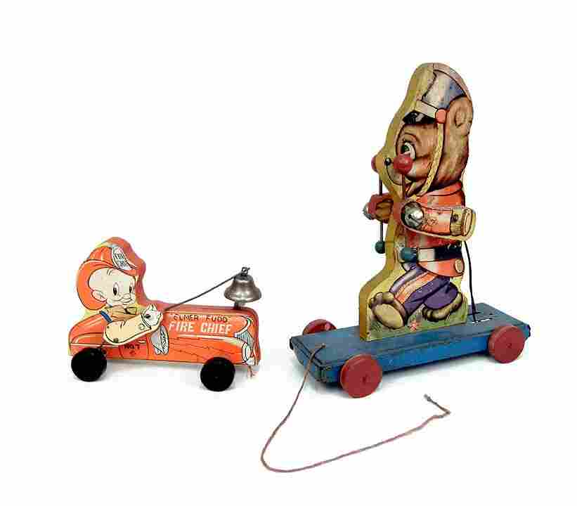 751: Two wooden pull toys, 1). Elmer Fudd Fire Chief No