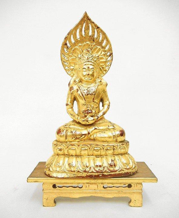 16: Bronze dore seated Bodhisattva, on gilt wood stand,