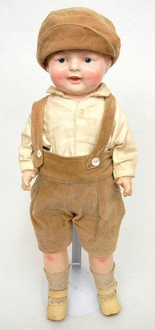 "9: Composition boy doll 16"" high, with cloth body, pain"
