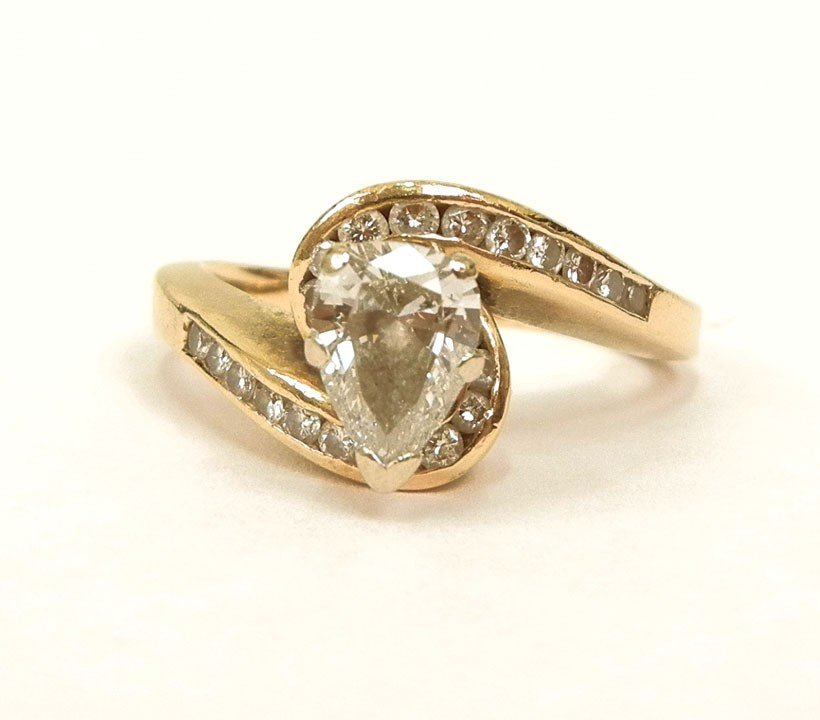 192: Pear shaped diamond solitaire engagement ring with