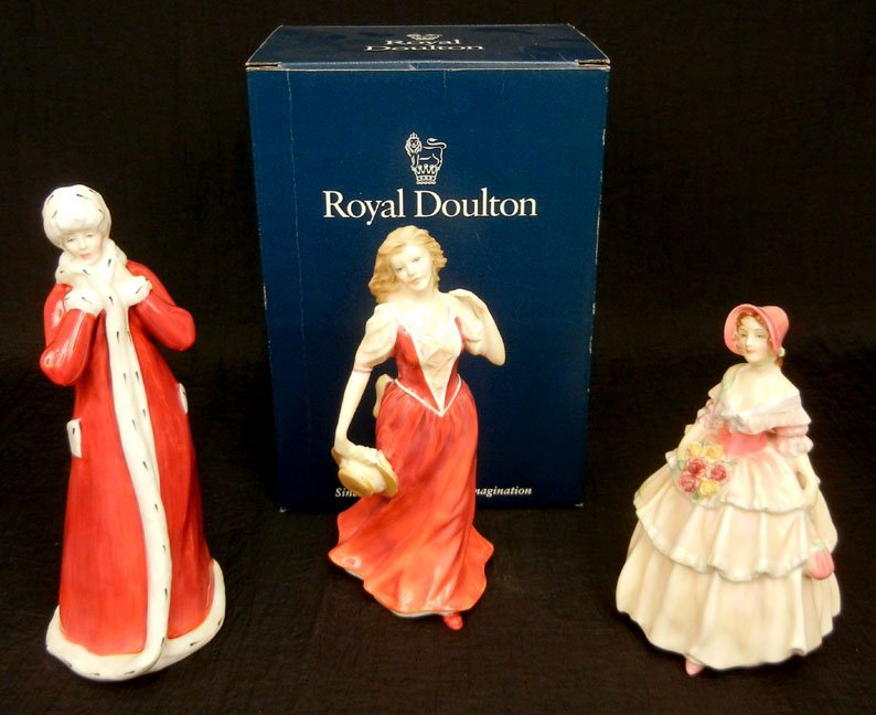 "1: Three Royal Doulton figurines, ""Wintertime"" HN 3060,"