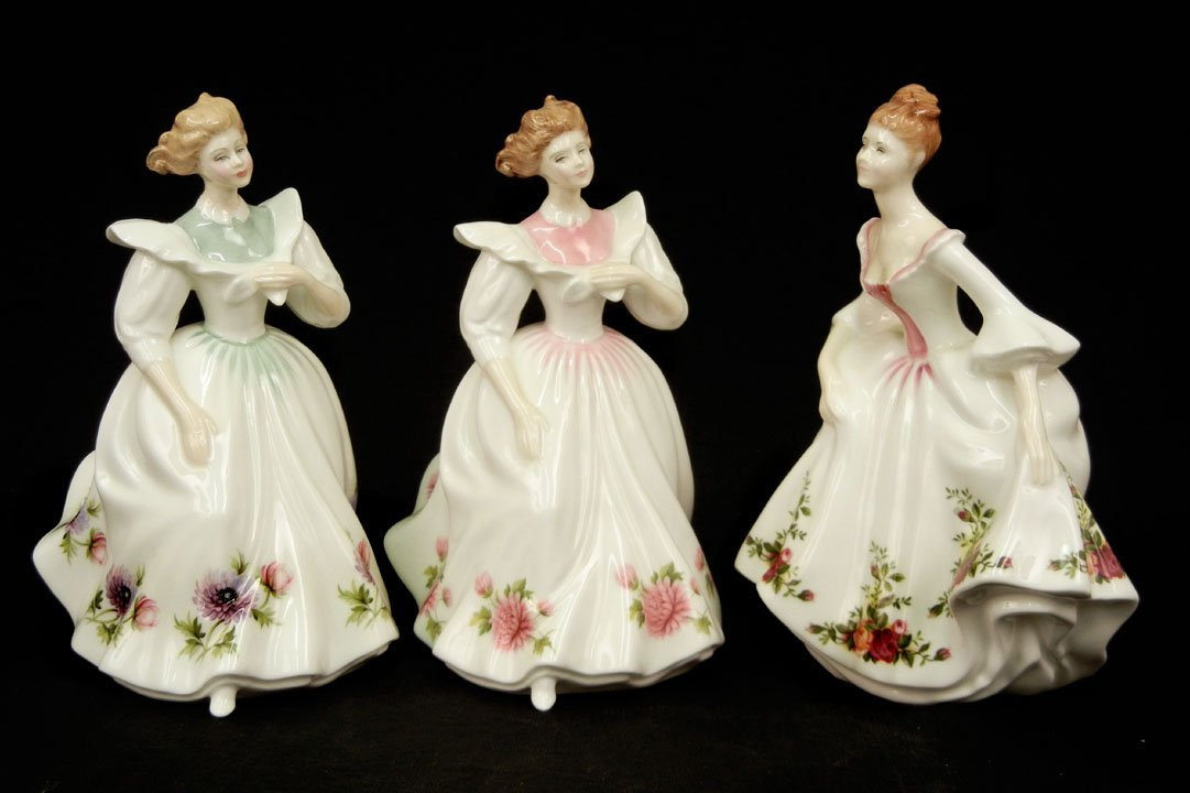 "28: Three Royal Doulton figurines ""Novemeber"" Figure of"