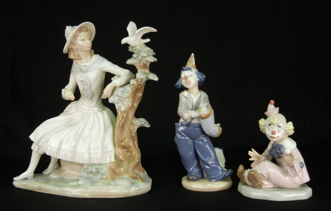 69: Three Nao by Lladro figurines, including a seated c