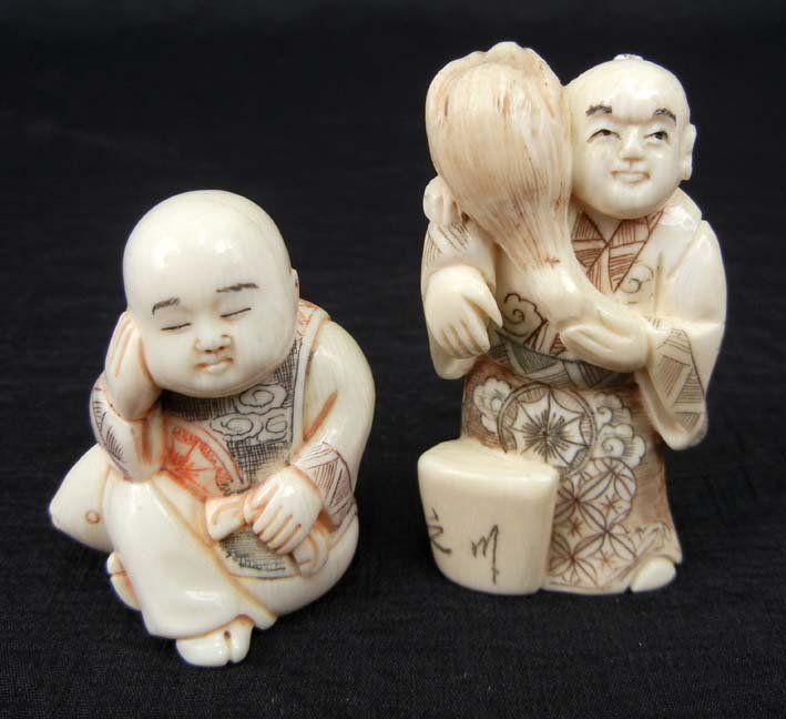 174: Two ivory netsukes, sleeping figure sitting on fis