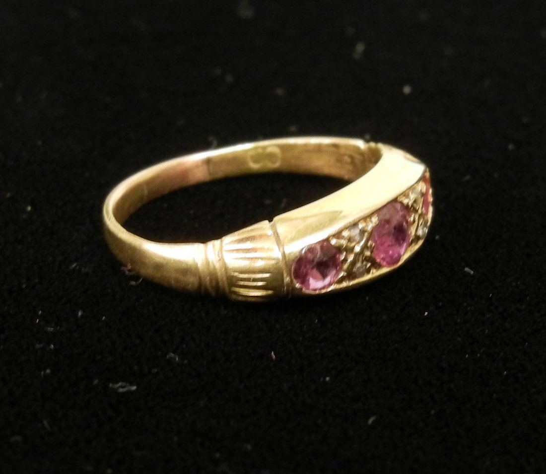 280: Gold and ruby gypsy ring, 14k gold set with three