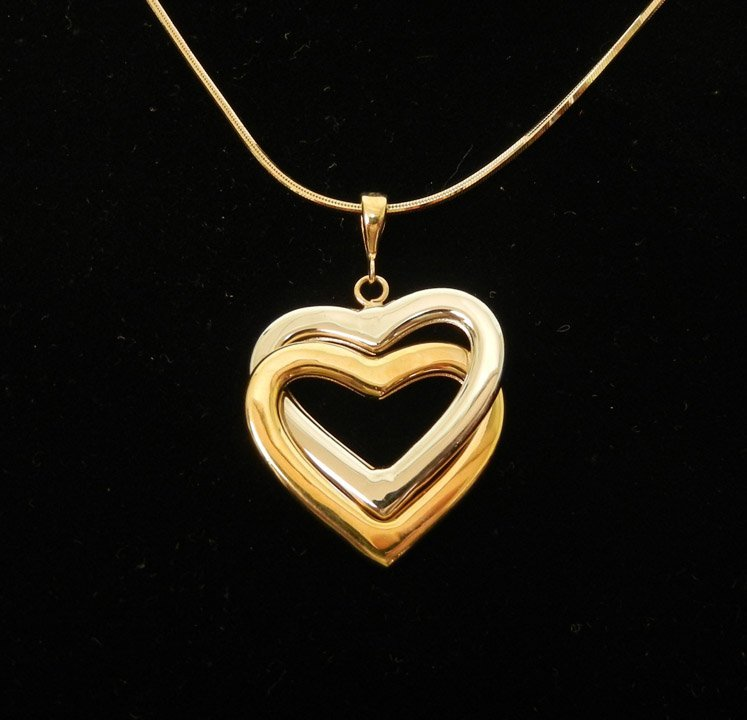 294: Two tone gold heart pendant with chain, 14k yellow