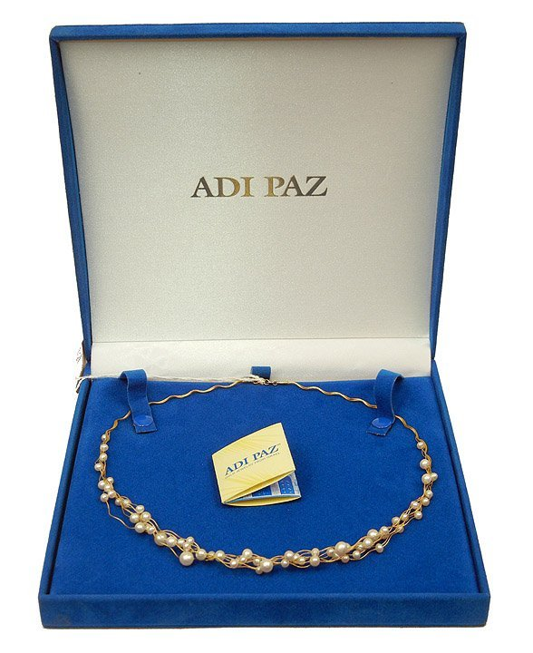 295: Adi Paz gold and pearl necklace, seven strands of