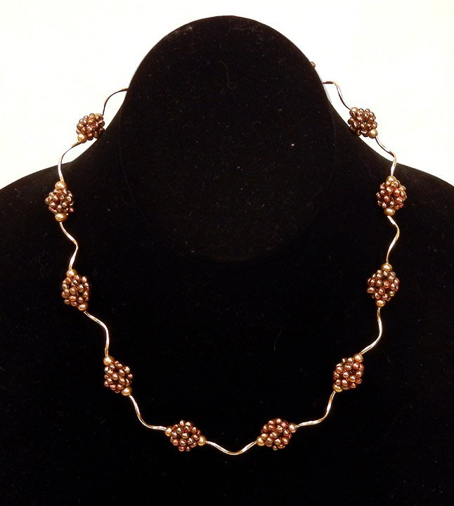 298: Gold and pearl necklace, 14k yellow gold twisted s