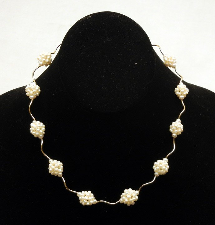 299: Gold and pearl necklace, 14k yellow gold twisted s