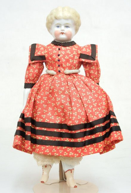 45: China head doll, painted eyes and closed mouth, mol