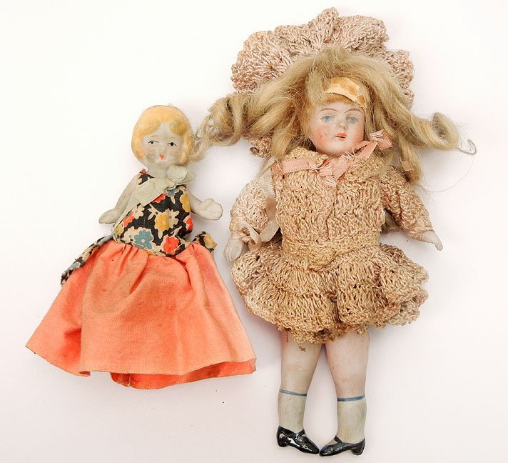 60: Two small all bisque dolls, painted eyes and mouths