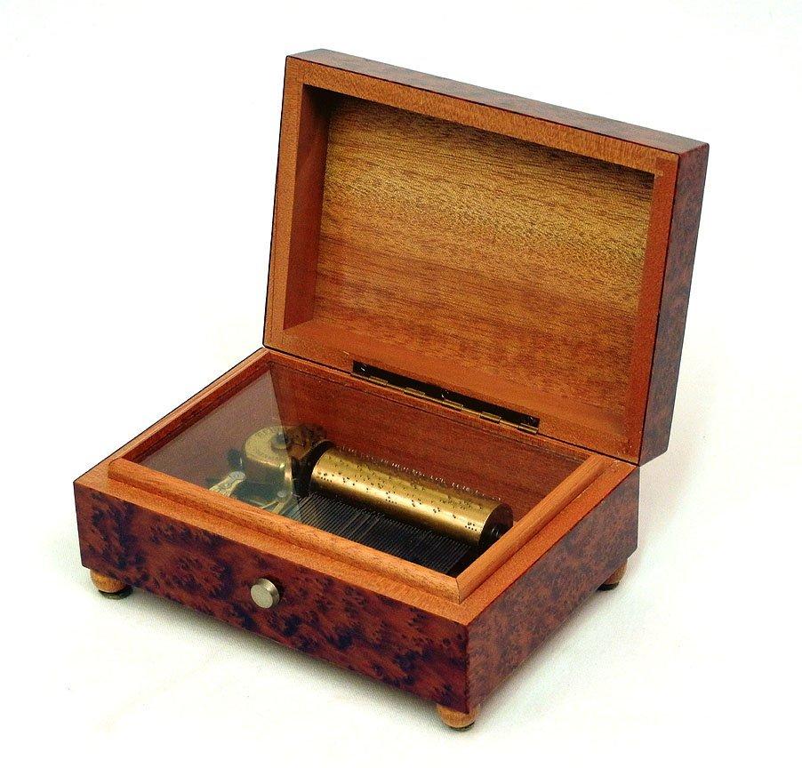 "5: Swiss cylinder music box, labeled on bottom ""Vienna,"