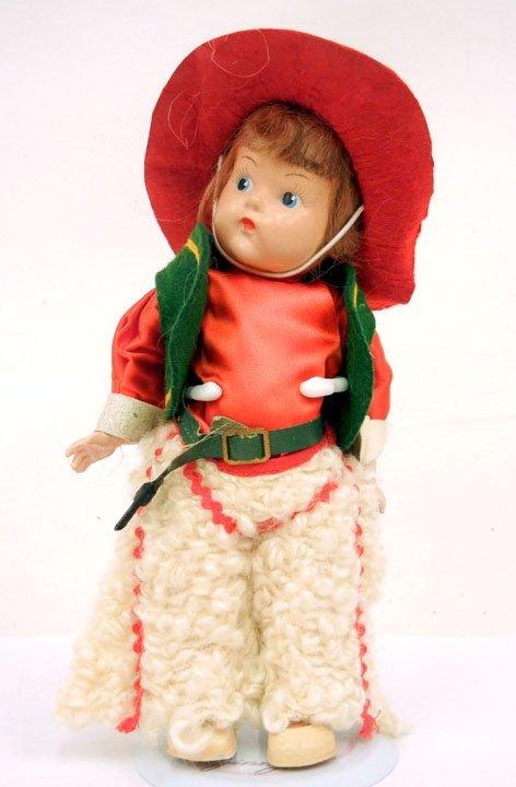 """8: Vogue strung Ginny, """"Cowboy"""", original outfit with r"""