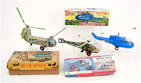 292 Two tin litho helicopters and a plastic battery o