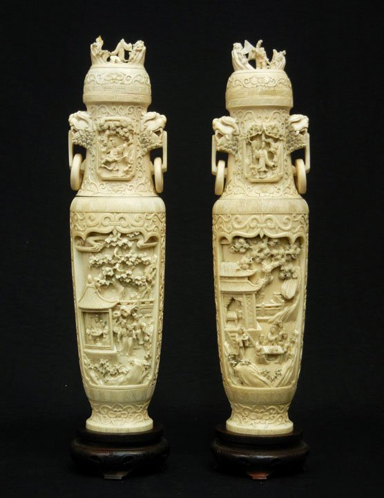 105: Pair of Chinese carved ivory figural covered urns,