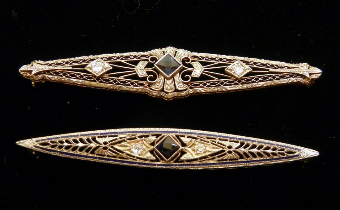 249: Two Art Deco white gold filigree diamond and sapph
