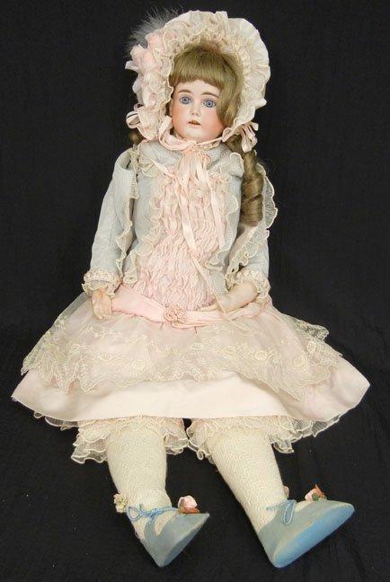 "German bisque shoulder head doll, 35"", cloth body, blue"