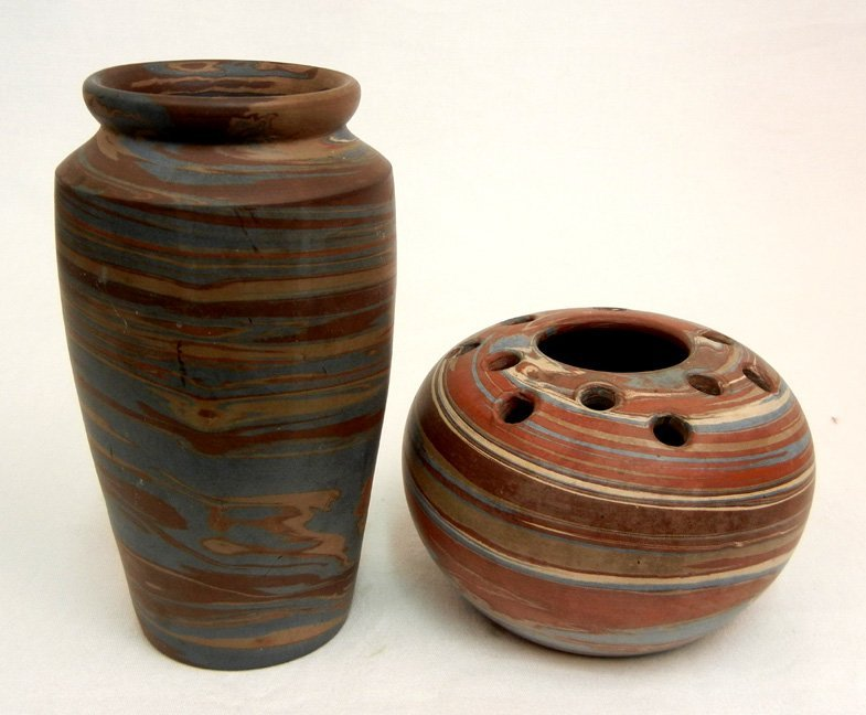 Two Niloak pottery vases, swirl design, one with flower