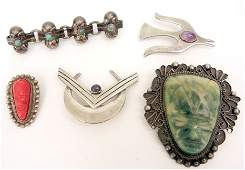 Five Mexican handmade sterling silver pins including ca