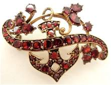 Victorian gold and garnet pin 10k gold mounting set wi