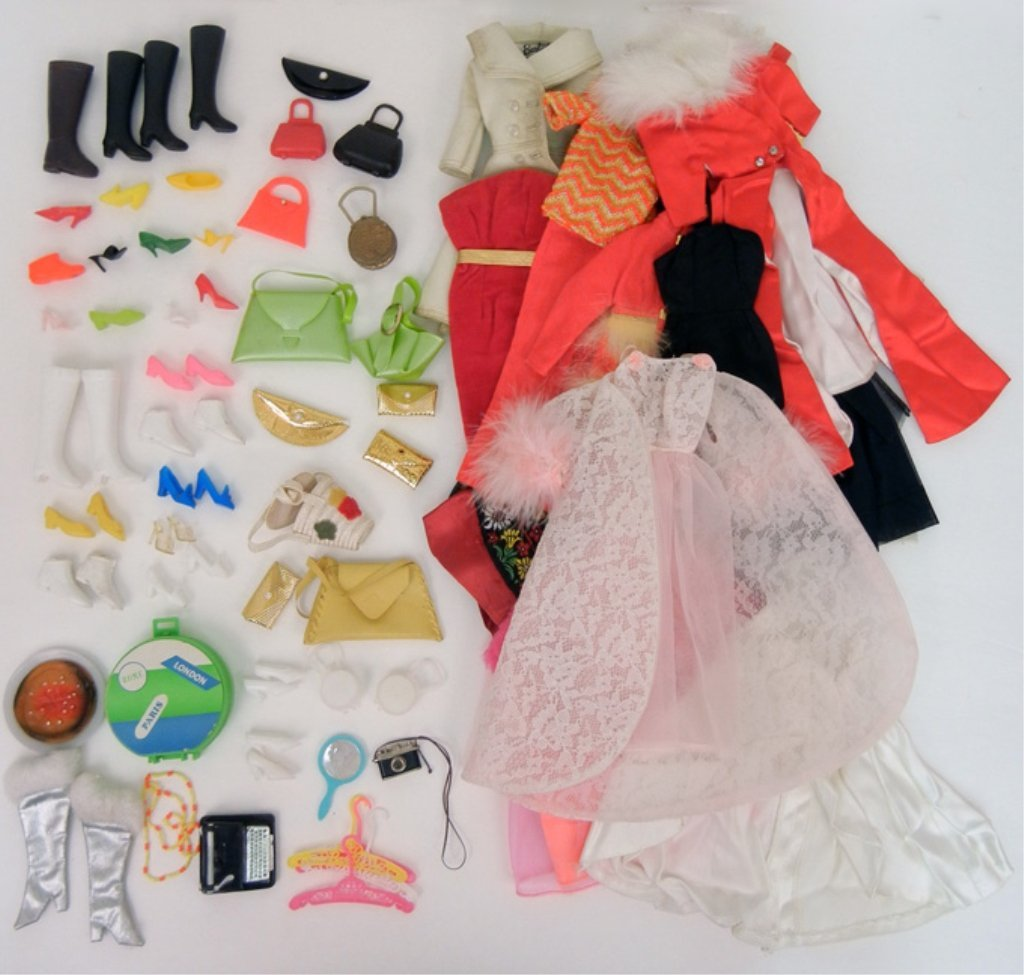 Grouping of Barbie and Fashion doll clothing, some