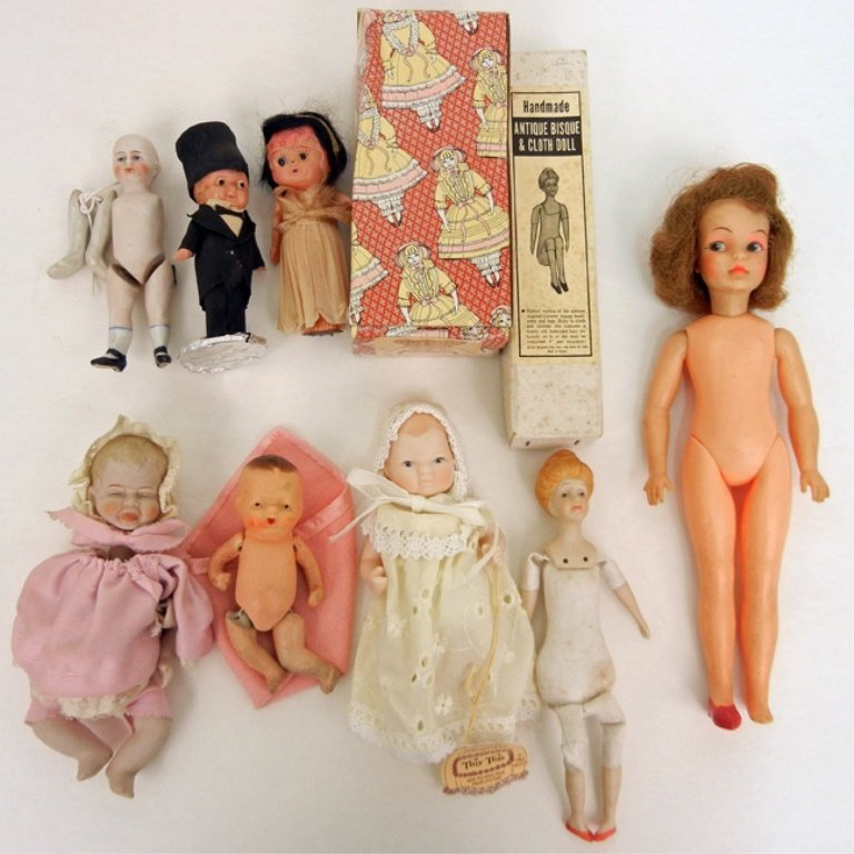 Grouping of assorted dolls, including bisque,