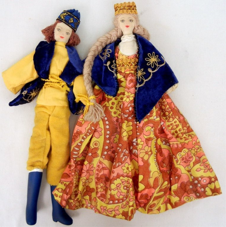 Two cloth dolls, wearing king and queen attire, painted