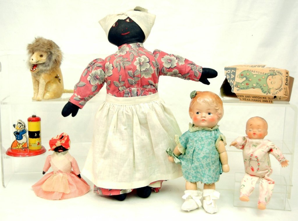 Assorted doll and toy grouping, including Lazy Dazy by