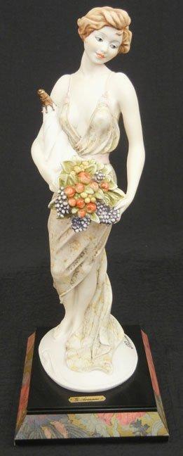 Giuseppe Armani figurine , lady holding bouquet of flow