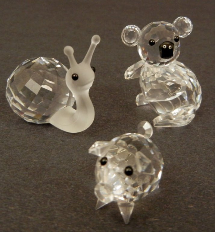 Grouping of five Swarovski crystal figurines, including