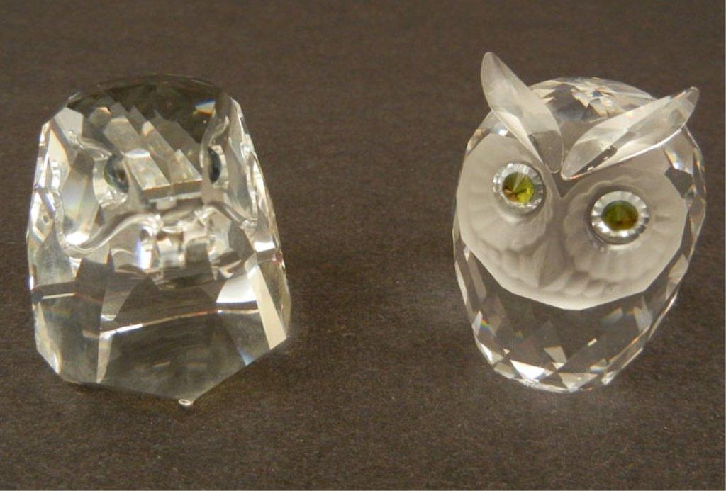 Two Swarovski crystal figurines, including an eagle hea