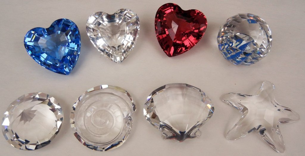 Grouping of eight Swarovski crystals, including three h