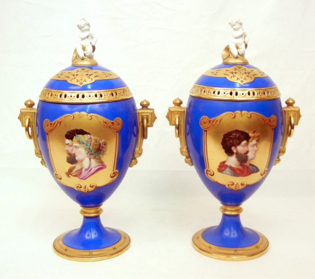 Pair of Sevres mantle urns, gilt cartouche with enamele