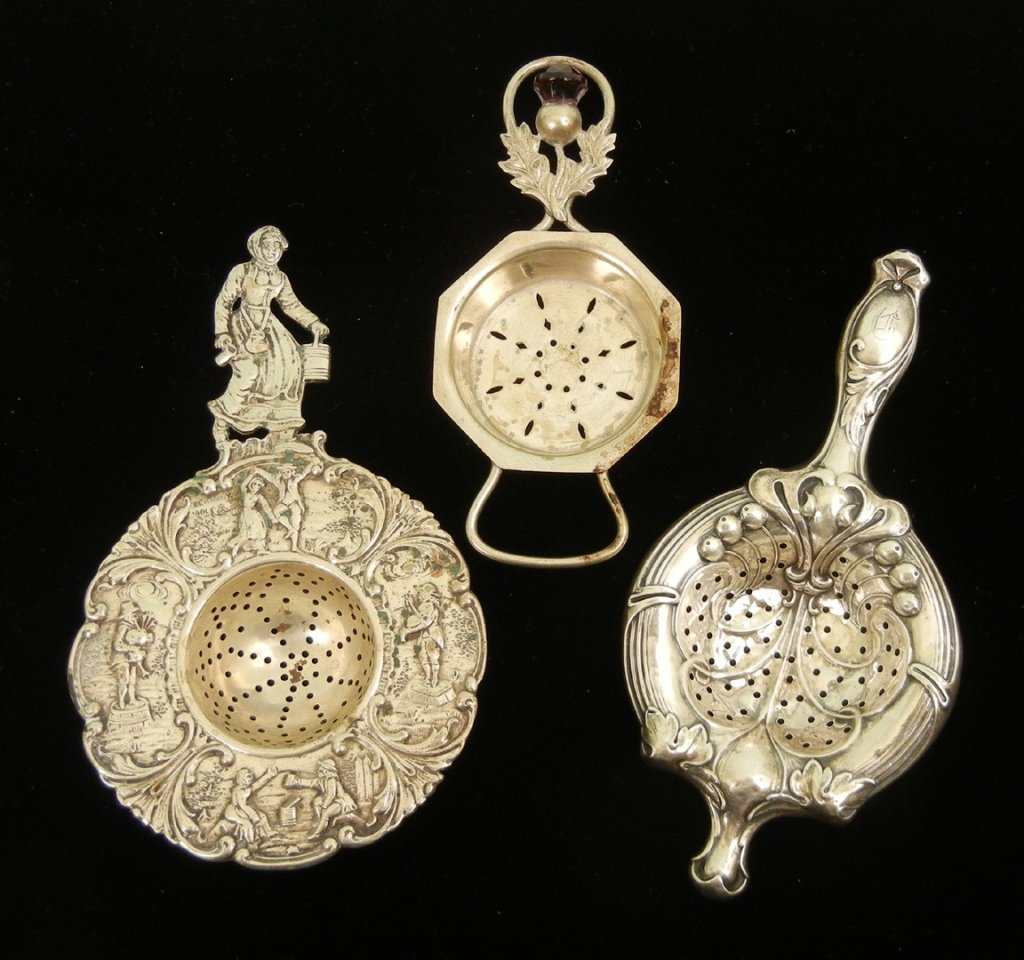 Grouping of three sterling silver and 800 silver tea st